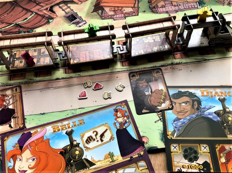 components of board game Colt Express with wild west and train theme